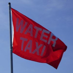 red flag guides you to water taxi stop
