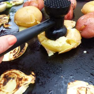 Evo grills flat top surface allows direct smashing of potatoes